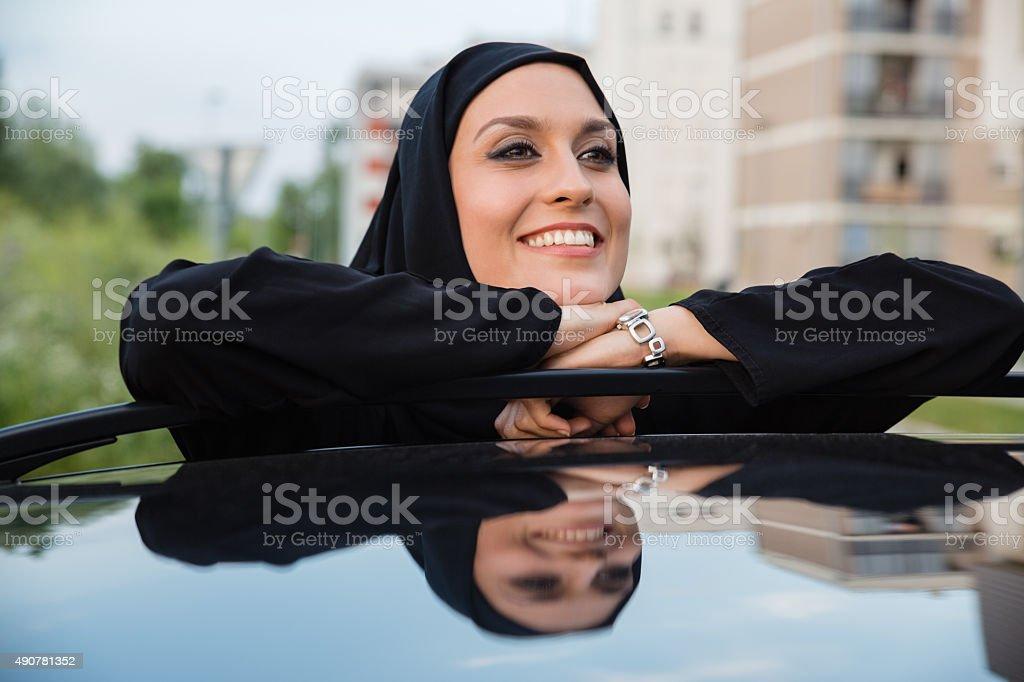 Young Arabian Woman Next To Car stock photo