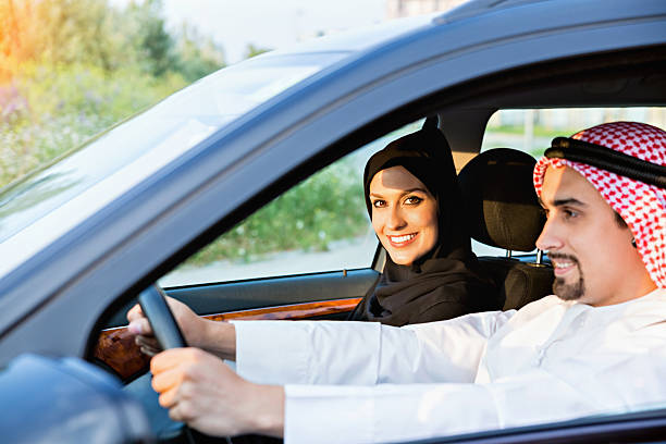 Young Arabic Couple In Car stock photo