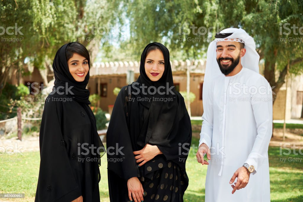 Young arabs in traditional clothing stock photo