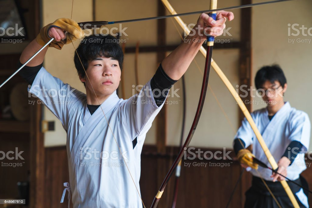 Young archer checking his target stock photo
