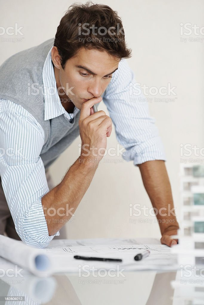 Young architect concentrating on his project royalty-free stock photo