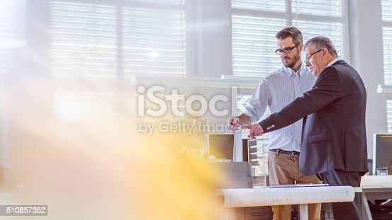 532257236istockphoto Young architect discussing project with his client 510857352