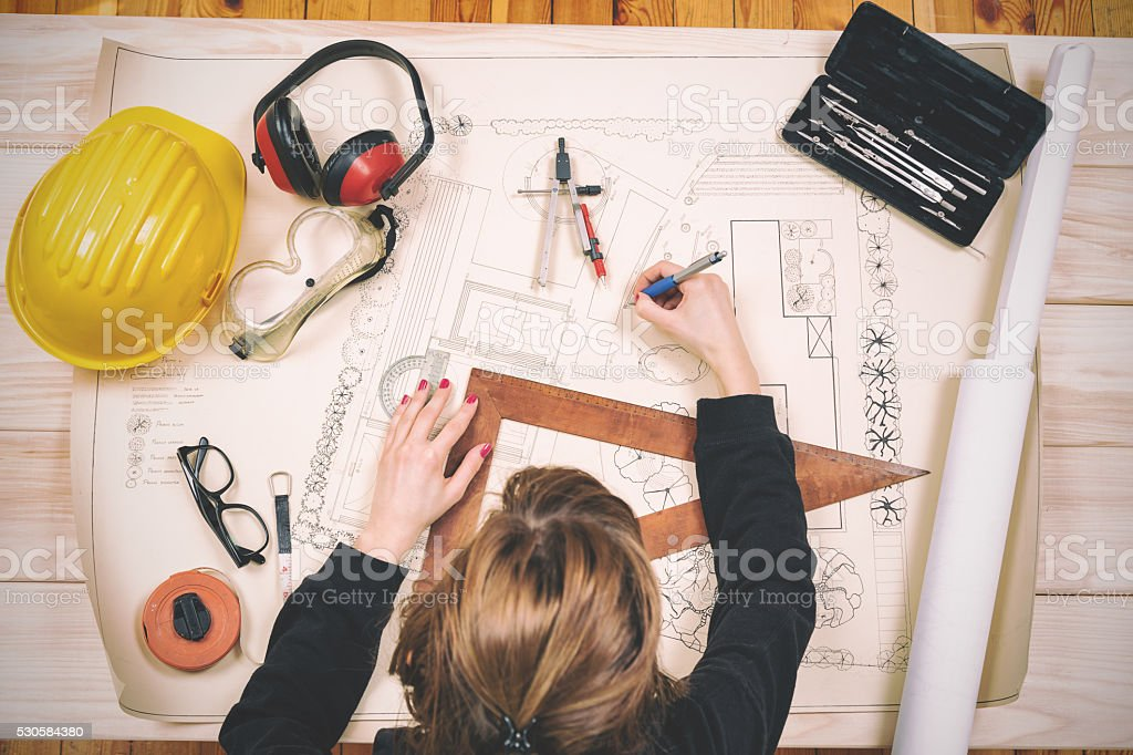 Young architect doing work in her studio. stock photo