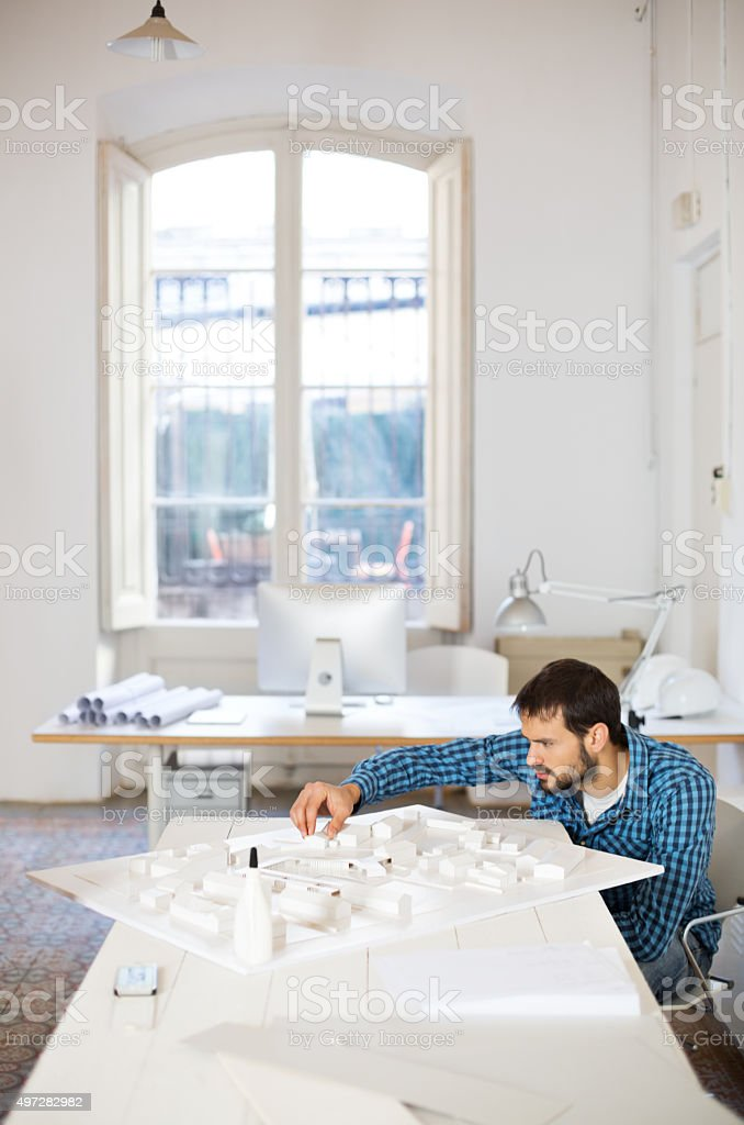 Young architect making architectural model stock photo