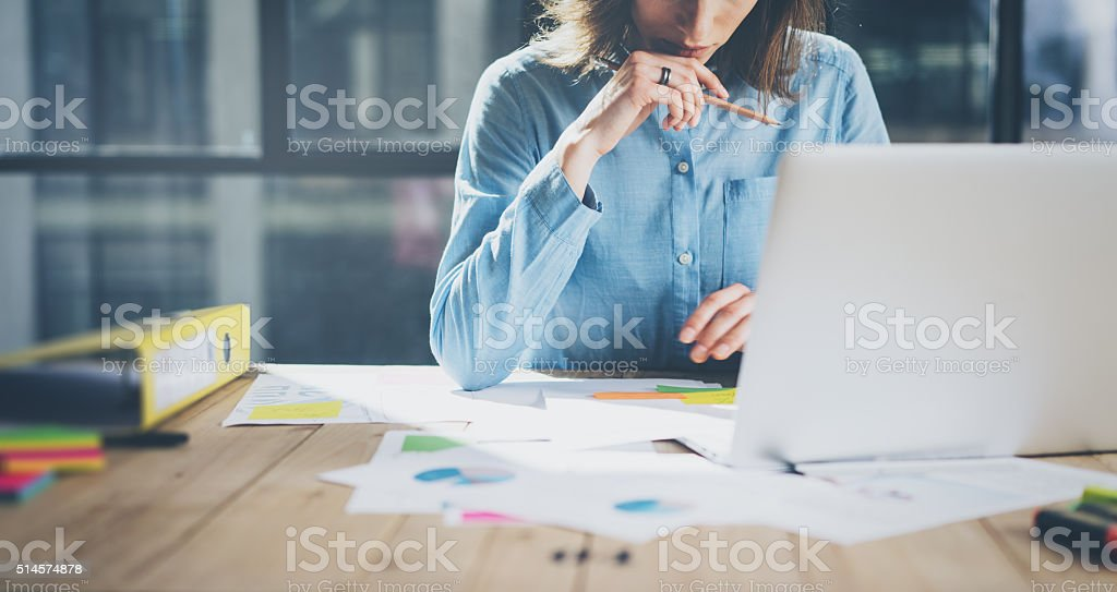 Young architect work project. Photo woman working with new startup stock photo