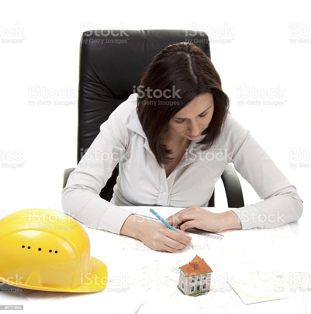 Young architect working on construction plans royalty-free stock photo