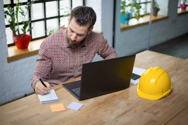 Young architect working on new ideas at his office stock photo