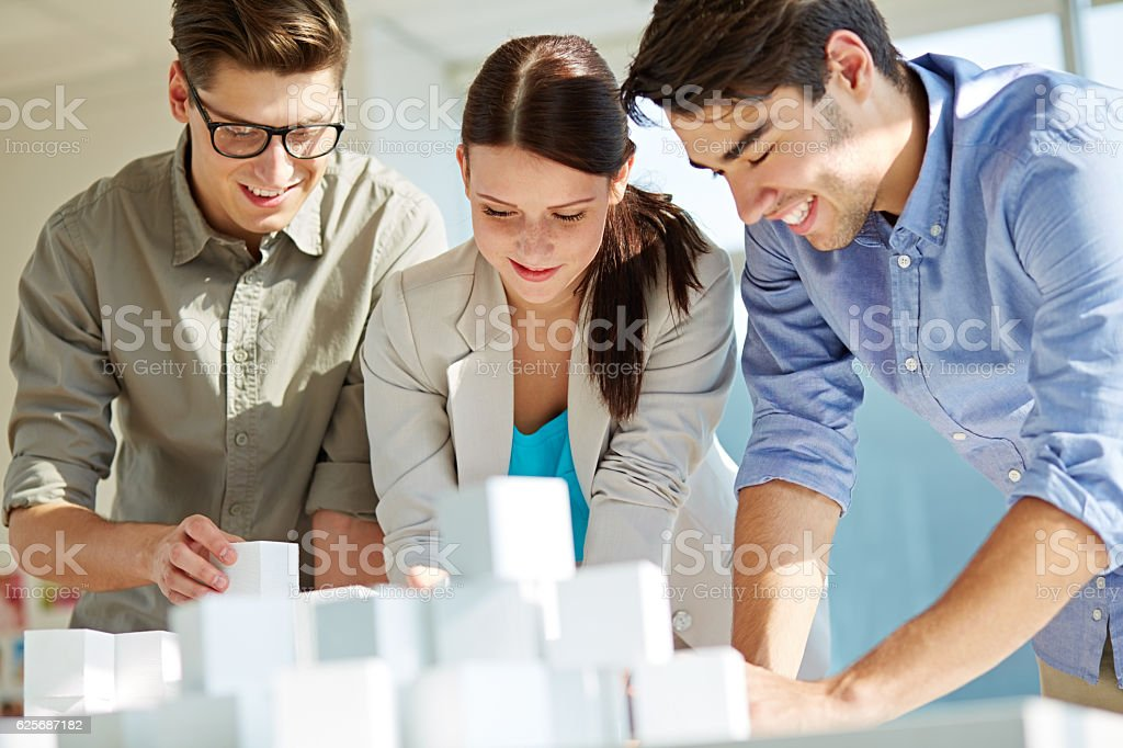 Young architects designing new project stock photo