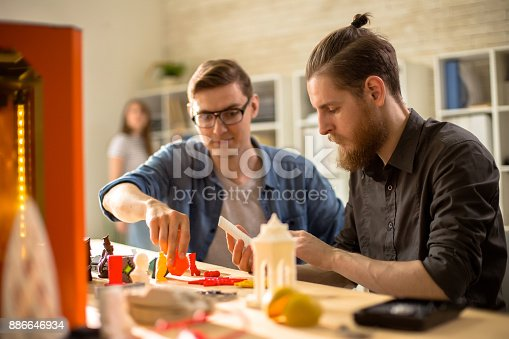 886646936 istock photo Young Architects Using 3D Printer 886646934