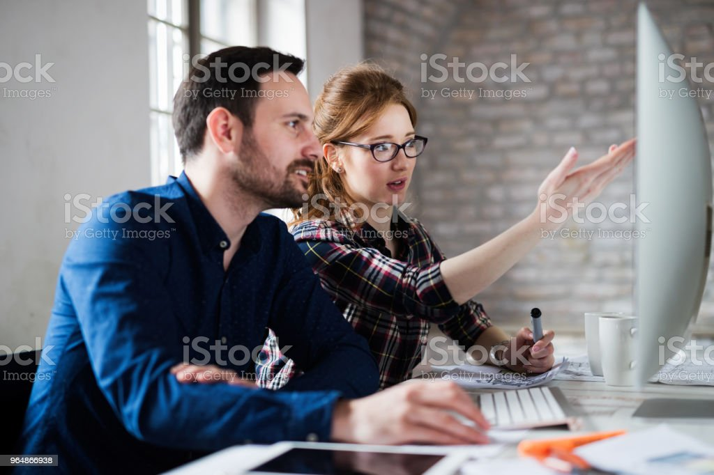 Young architects working on project in office royalty-free stock photo