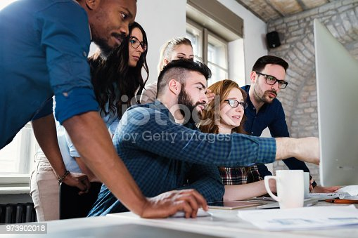 istock Young architects working on project in office 973902018