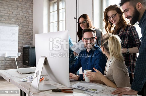 istock Young architects working on project in office 973902186