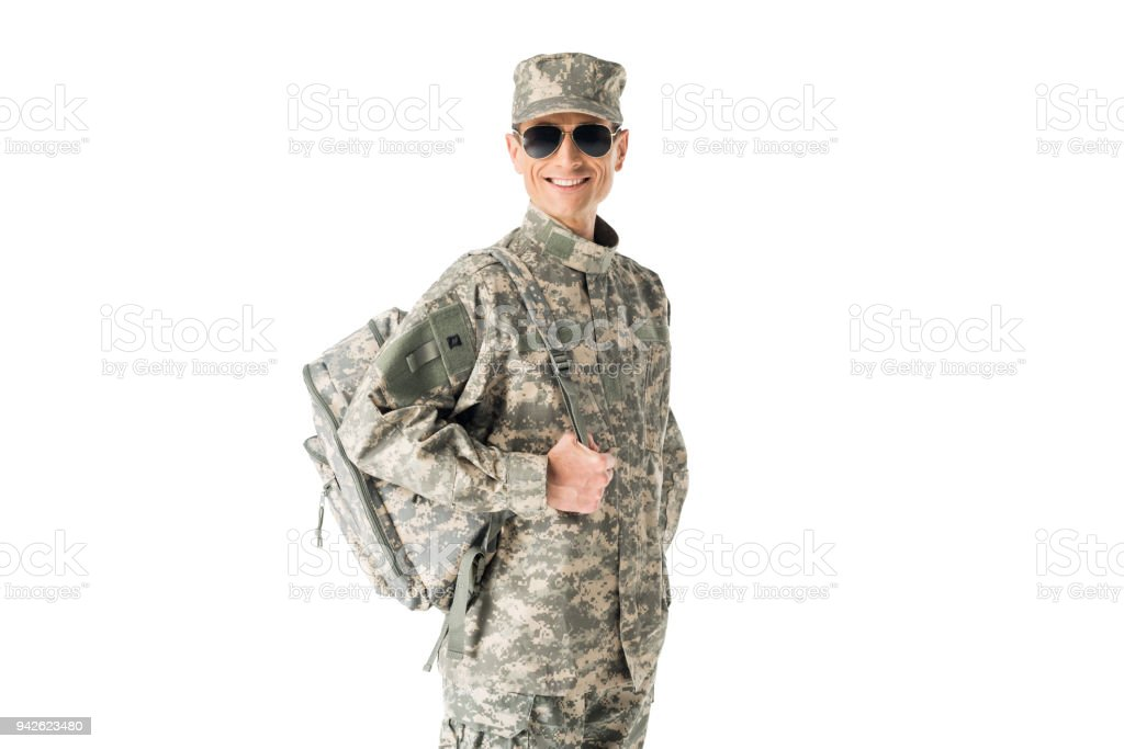 13587dbacf Young army soldier wearing uniform and sunglasses isolated on white  royalty-free stock photo