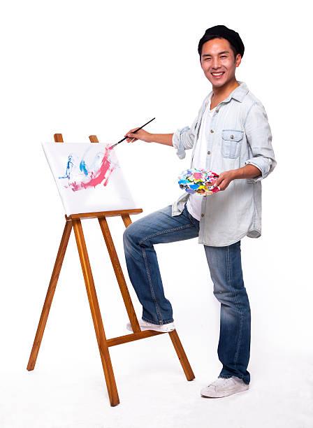 young artist painting picture - bemalte turnschuhe stock-fotos und bilder