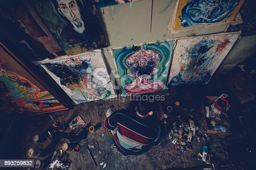 865169666 istock photo Young artist working on a painting in studio 893259832