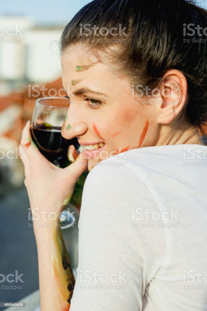 Young artistic woman with red wine in hands foto stock royalty-free
