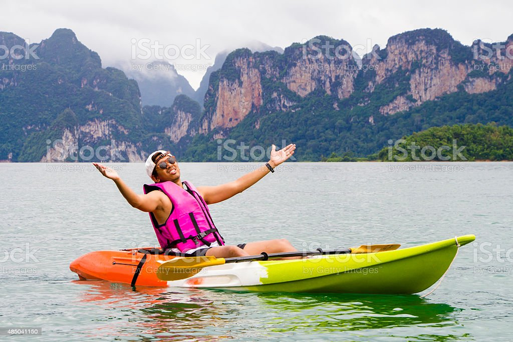 Young Asia Man Paddling In Chiewlarn Dam Thailand Stock Photo More
