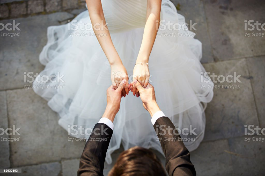 young asian adults dancing in wedding dress stock photo
