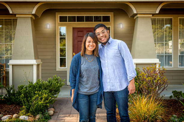 young asian american couple at home - house hunting stock photos and pictures