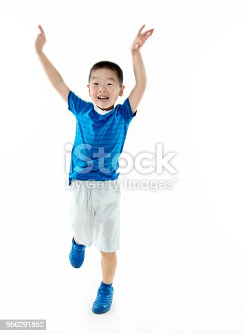 istock Young asian boy jumping against white background 956291852