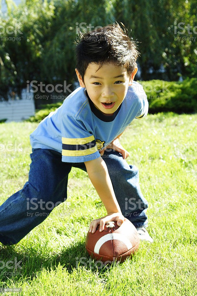 Young Asian boy playing football royalty-free stock photo