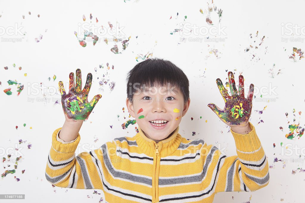 Young  Asian boy playing with finger paints royalty-free stock photo