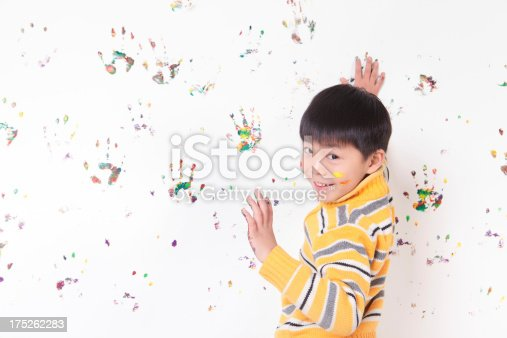 istock Young  Asian boy playing with finger paints 175262283
