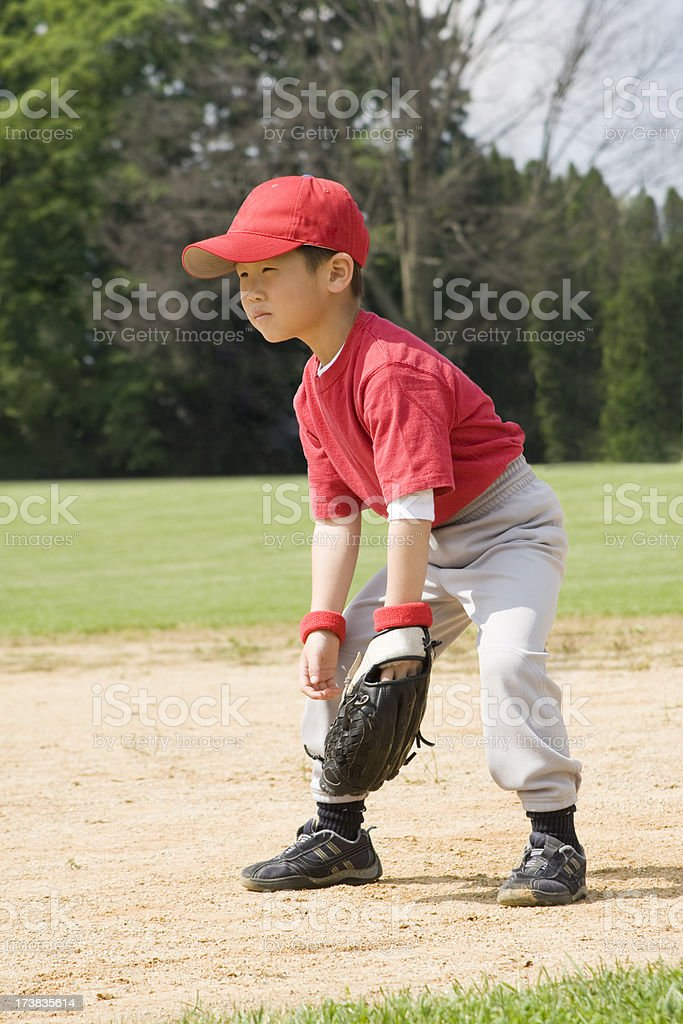 Young Asian Boy Plays Baseball or T-ball stock photo