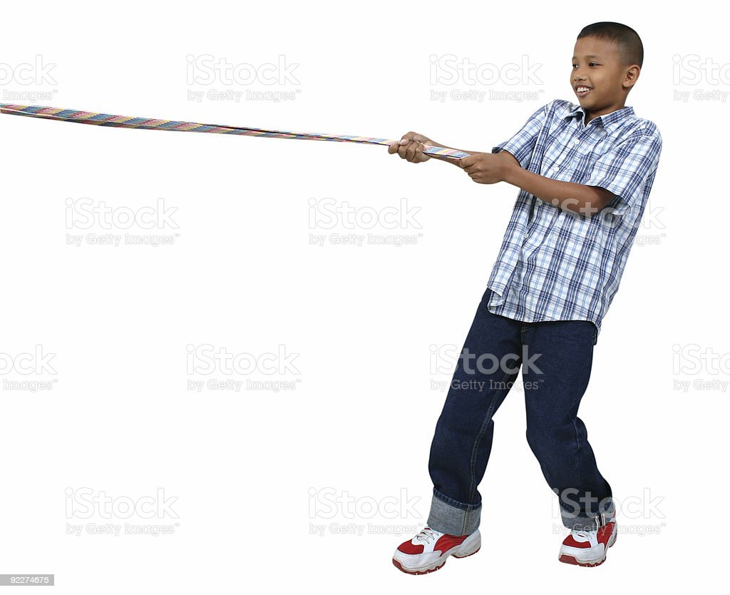 young asian boy pulling a rope royalty-free stock photo