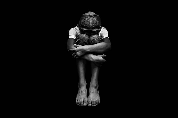 Young Asian boy, scared and alone Young Asian boy, scared and alone. Hoping for a better future than the one that seems set. He is at high risk of being physically, mentally and emotionally abused and also trafficked. trafficking stock pictures, royalty-free photos & images