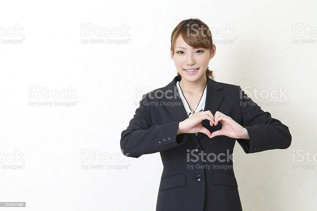 young asian buisiness woman make heart shape by her hands royalty-free stock photo