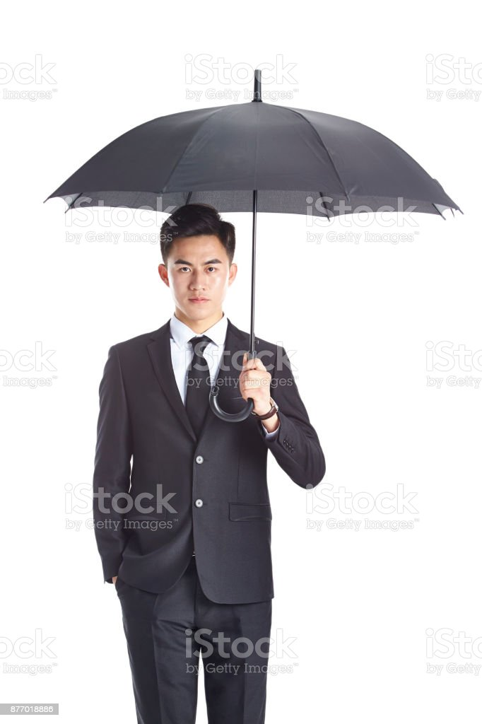 young asian business man holding an umbrella stock photo more