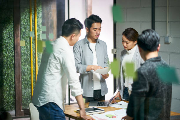 young asian business people meeting in office stock photo