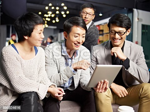 istock young asian business people using tablet in office 595324616