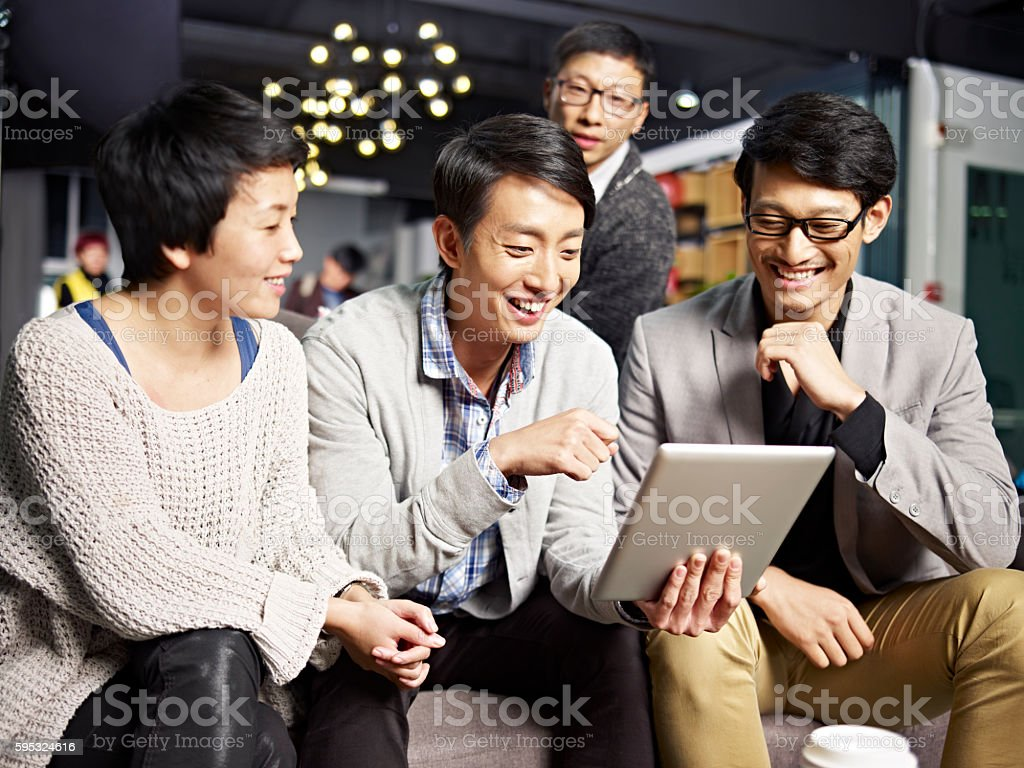 young asian business people using tablet in office stock photo