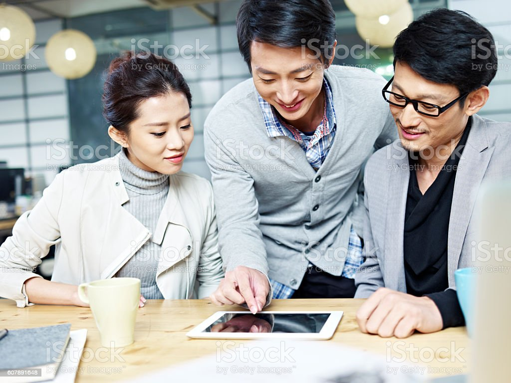 young asian business team working in office stock photo