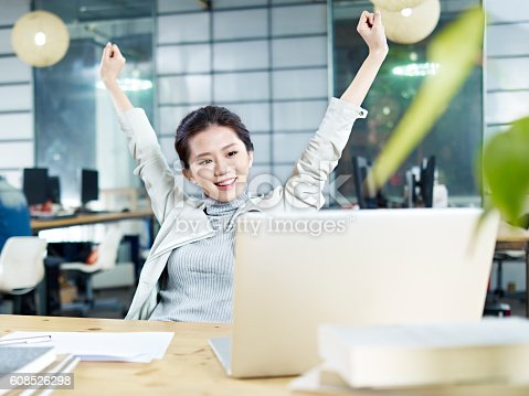 istock young asian business woman celebrating in office 608526298