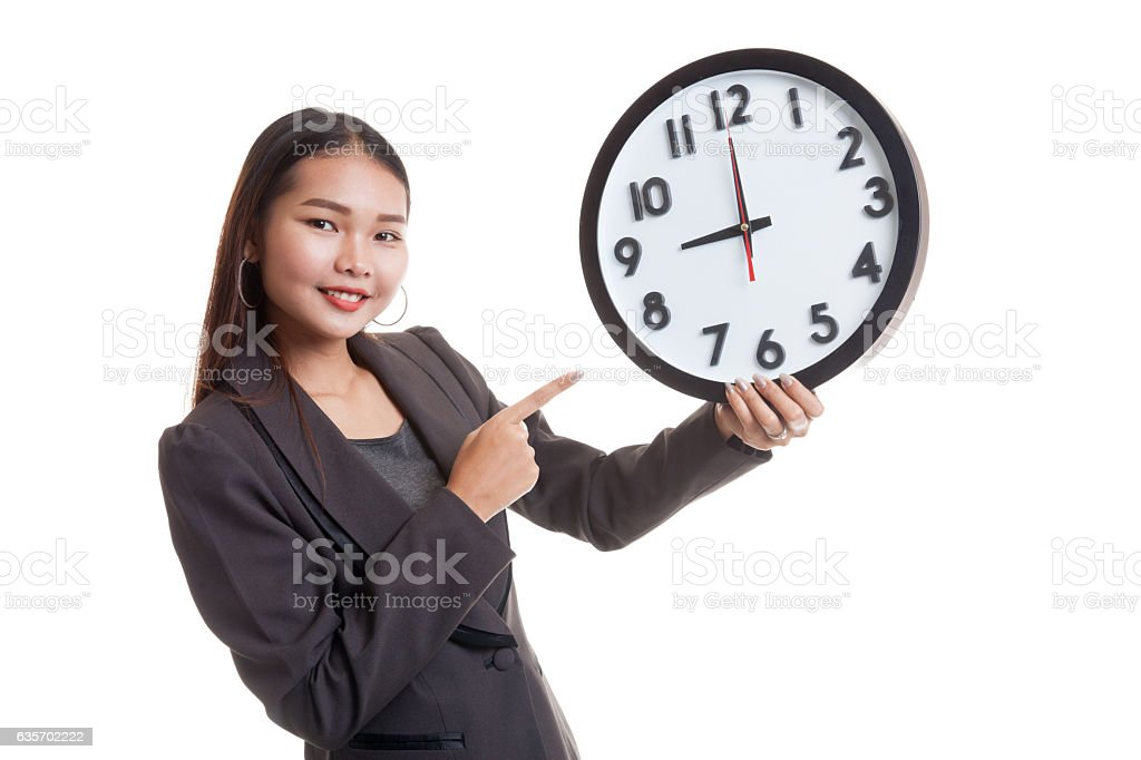Young Asian business woman point to a clock. royalty-free stock photo