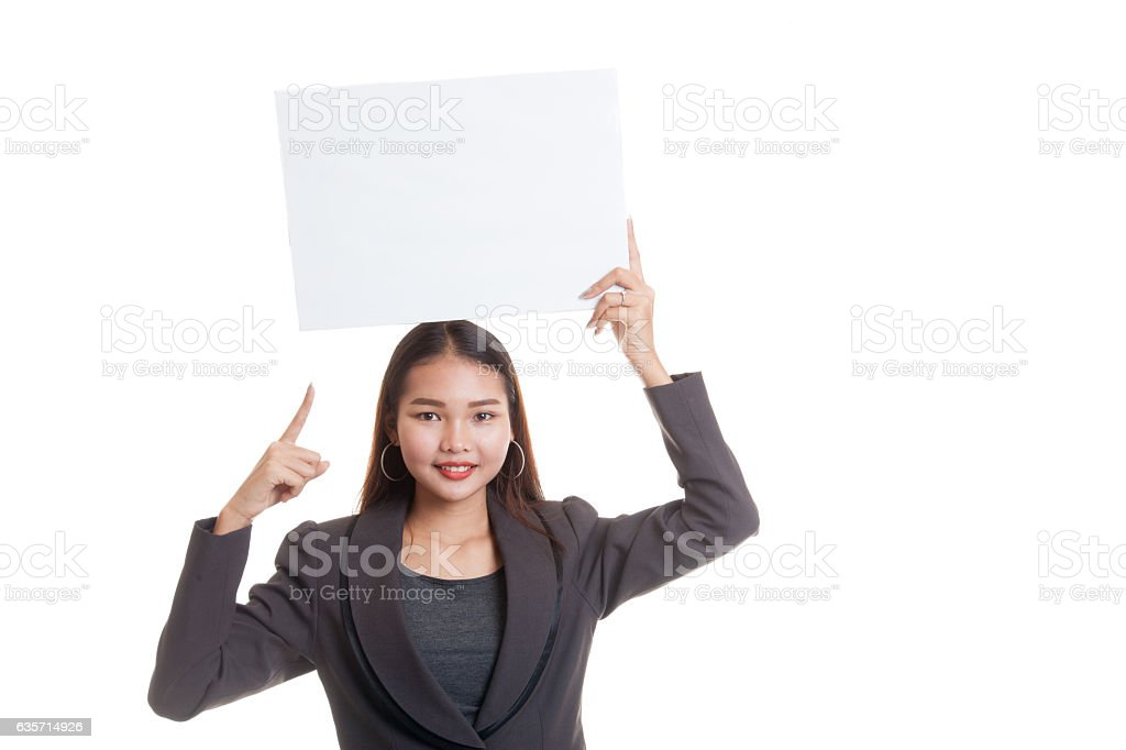 Young Asian business woman point to  blank sign. royalty-free stock photo