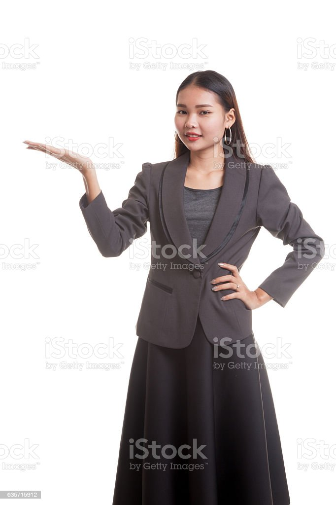 Young Asian business woman present with her hand. royalty-free stock photo