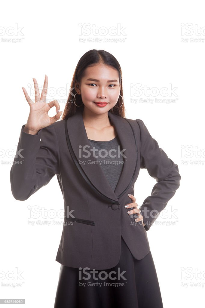 Young Asian business woman show OK sign. royalty-free stock photo