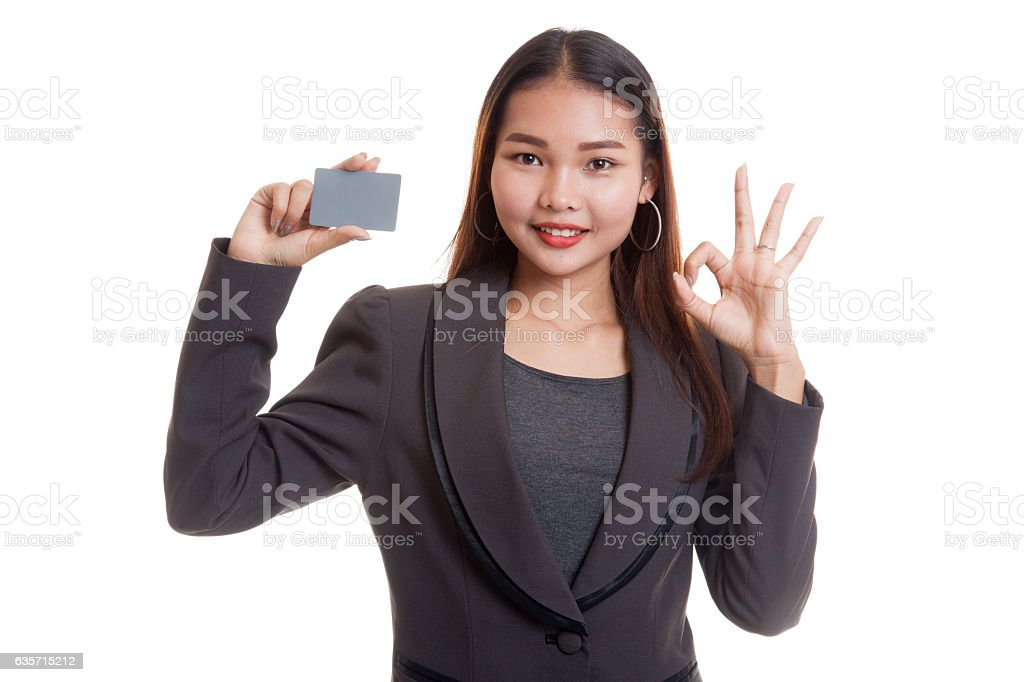 Young Asian business woman show OK with a blank card. royalty-free stock photo