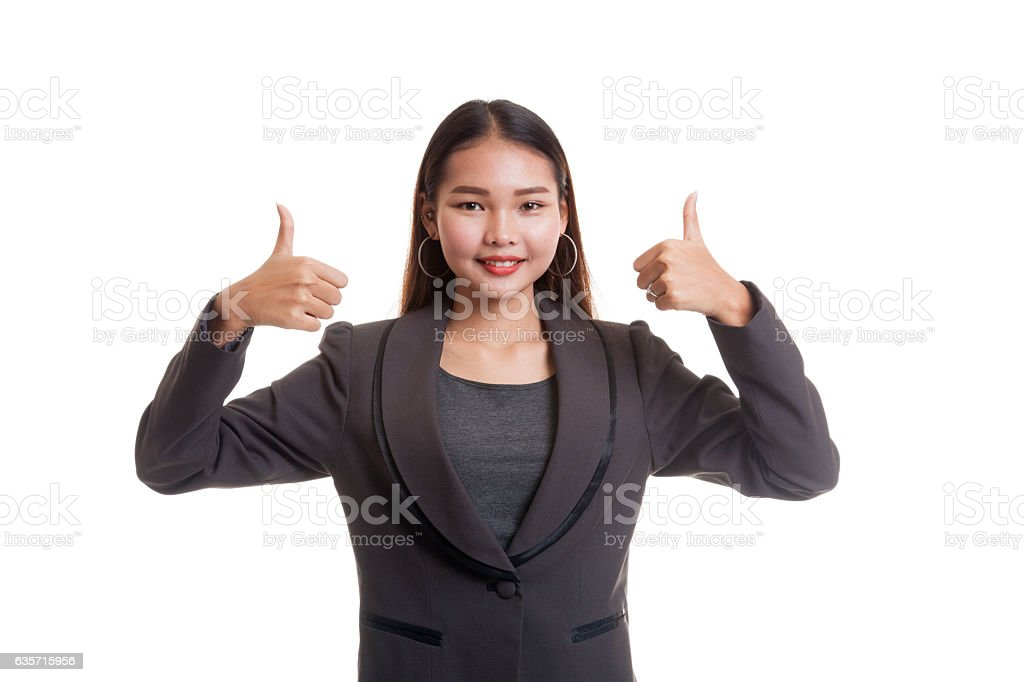 Young Asian business woman show two thumbs up. royalty-free stock photo
