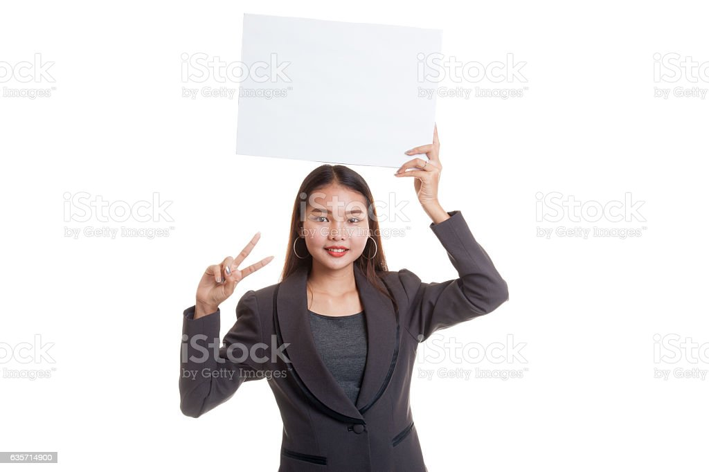 Young Asian business woman show victory sign with blank sign. royalty-free stock photo