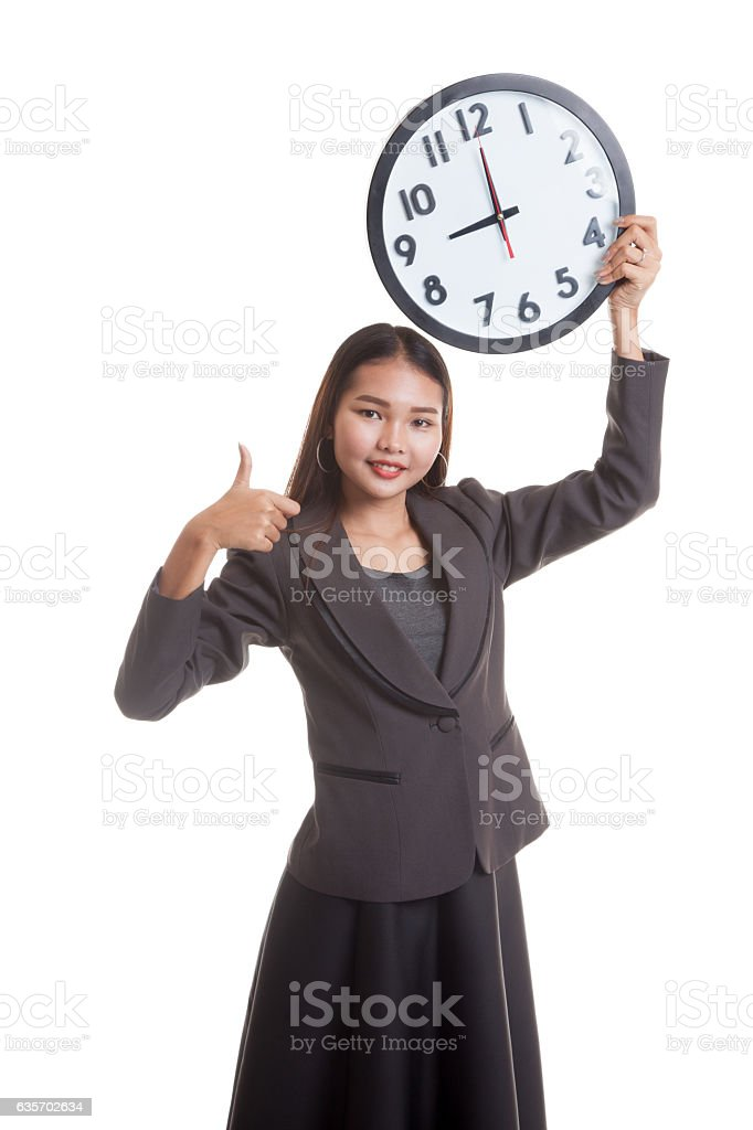 Young Asian business woman thumbs up with a clock. royalty-free stock photo