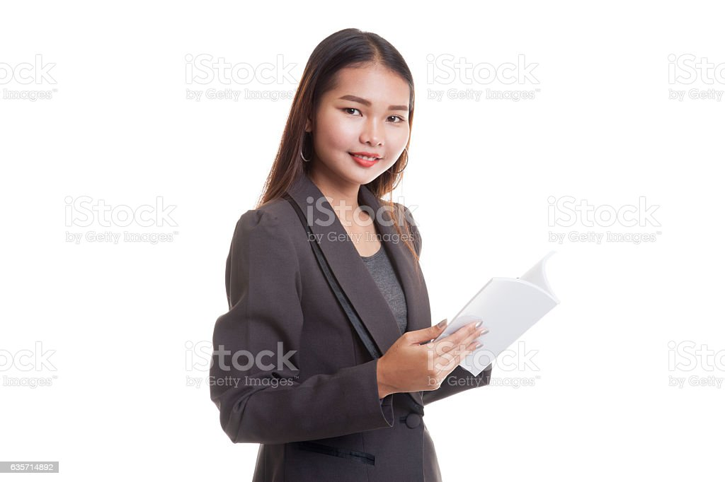 Young Asian business woman with a book. royalty-free stock photo