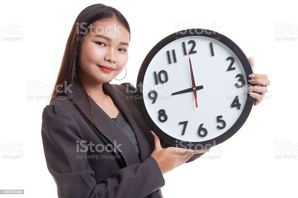 Young Asian business woman with a clock. royalty-free stock photo