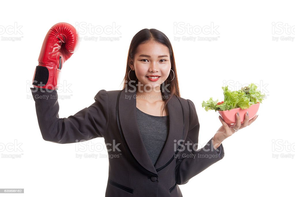 Young Asian business woman with boxing glove and salad. royalty-free stock photo