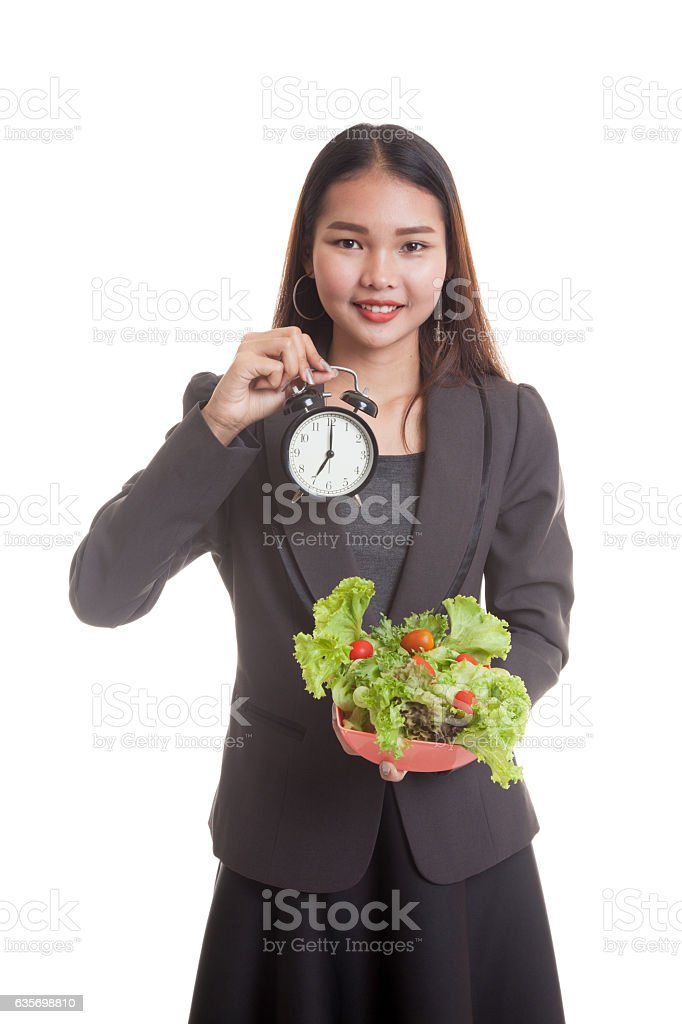 Young Asian business woman with clock and salad. royalty-free stock photo
