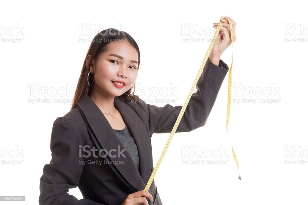 Young Asian business woman with measuring tape. royalty-free stock photo